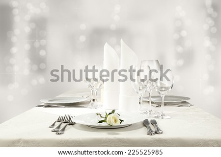 white roses and silver table of food  - stock photo