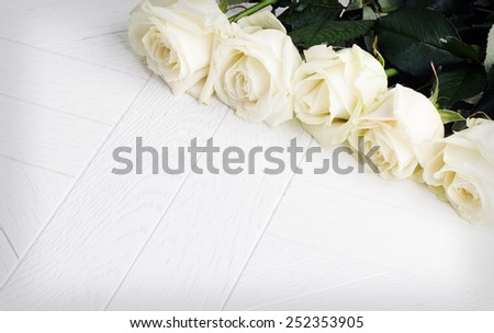 white  roses at wooden background