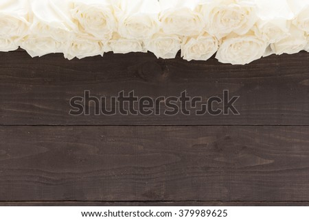 White roses flower are on the wooden background. - stock photo