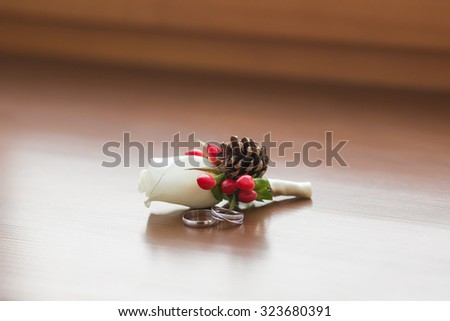 white roses groomsmen boutonniere and wooden background