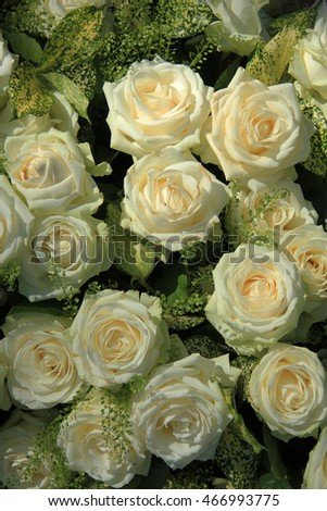 White roses in a bridal bouquet