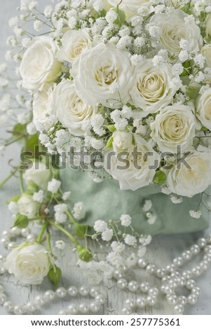White roses in a green bag - stock photo