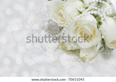 White roses on white lace background.