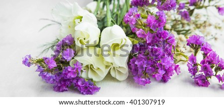White roses with purple flowers bouquet, spring blossom bouquet