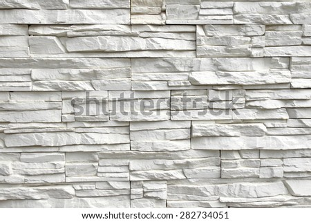 White Rough Tilled Stone Wall Background Texture Detail. - stock photo