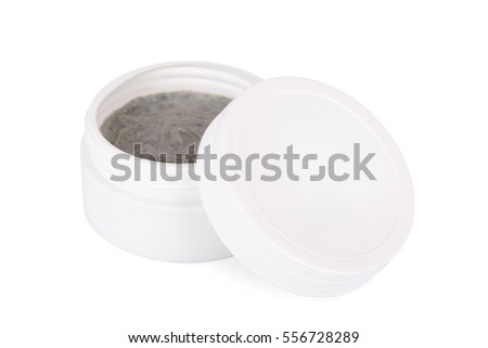 white round glass container with gray cream and open plastic cap isolated on white background