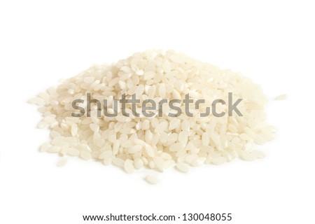 White round grain rice on a white background - stock photo