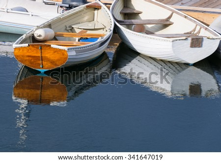 White Rowboats Reflecting in Water - stock photo