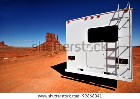 White RV at Monument Valley - stock photo