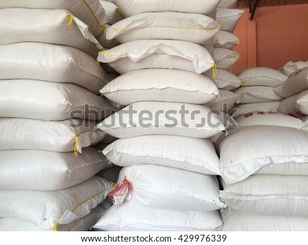 white sacks of rice in warehouse
