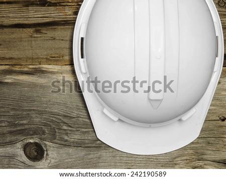 white safety hat on wood background - stock photo
