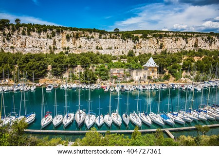 White sailboats moored in rows near the shore. Picturesque small bay - Calanques with turquoise water between Marseille and Cassis - stock photo