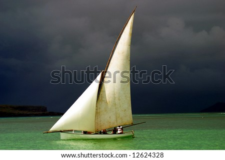 White sailed pirogue on the ocean (Mauritius)