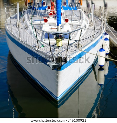 White sailing boat in a harbour - stock photo