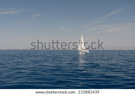 White sailing yacht in the blue sea - stock photo