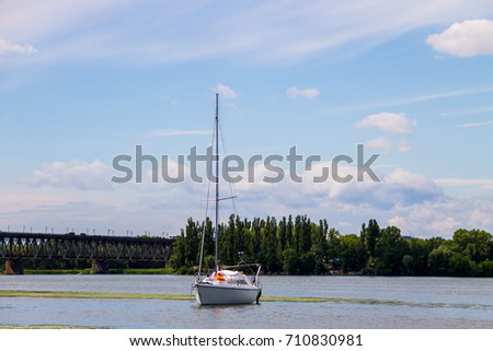 White sailing yacht on the river Dnieper