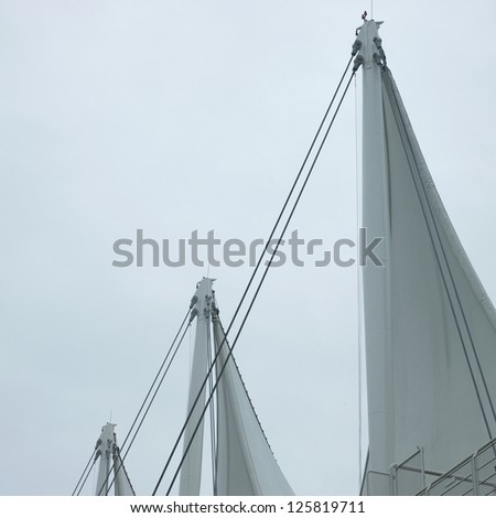 White sails and sky - stock photo