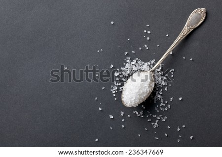 white salt on black background - stock photo