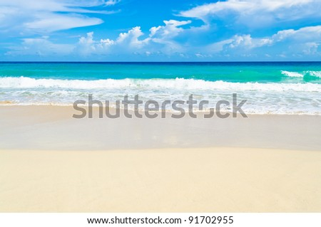 White sand and the ocean in a Caribbean beach - stock photo