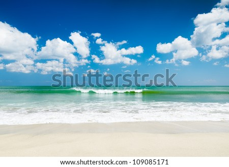 White sand beach and blue sky. - stock photo