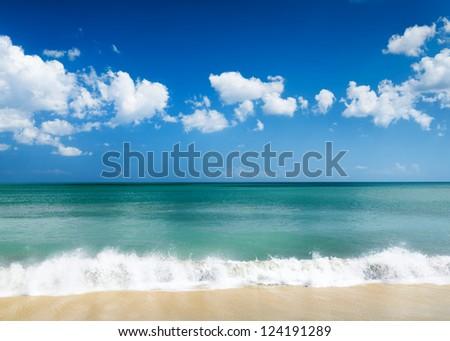 White sand beach and blue sky. - stock photo