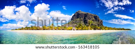 White sand beach and Le Morne Brabant mountain, Mauritius beach panorama - stock photo