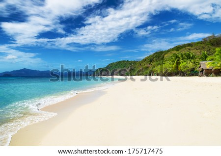 White sand beach. Malcapuya island, Philippines. - stock photo