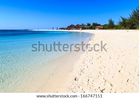 White sand beach of a resort on a tropical island on a sunny day