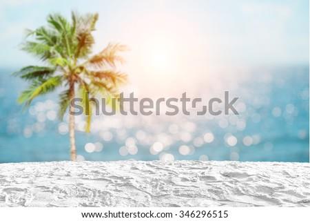 white sand beach on coconut tree and bokeh light sea background - stock photo