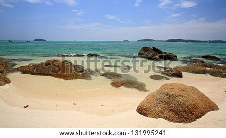 White sand beach with beautiful rock and crystal andaman sea at Koh Khai near Koh Tarutao in Satun, Thailand - stock photo