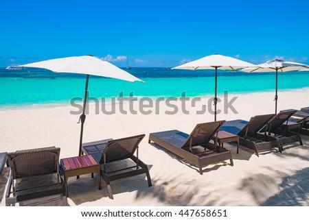 White sand beach with umbrellas, Boracay island, Philippines - stock photo