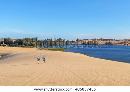 white sand dune desert and lake in Mui Ne, Vietnam. - stock photo