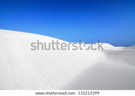 White sand dunes and wind swept waves of Socotra island, Yemen