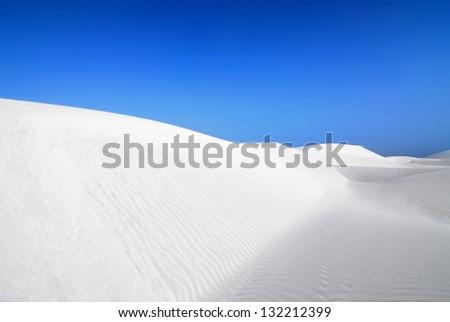White sand dunes and wind swept waves of Socotra island, Yemen - stock photo