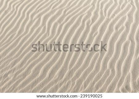 White sand ripples on a tropical beach - stock photo