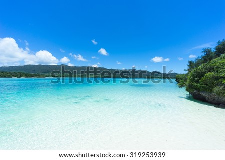 White sand tropical beach and clear blue lagoon water of Southern Japan, Ishigaki Island of the Yaeyama Islands, Okinawa - stock photo