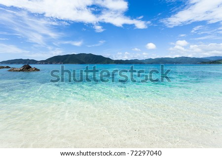 White sand tropical beach and horizon over clear blue aquamarine water of coral islands, Amami Islands, Kagoshima, Japan - stock photo