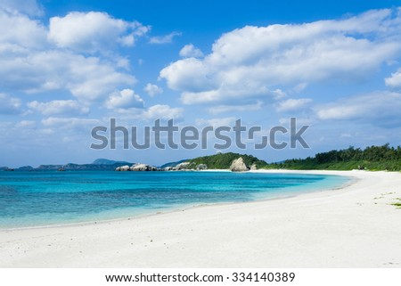 White sand tropical beach with clear blue water, Tokashiki Island of the Kerama Islands National Park, Okinawa, Japan - stock photo