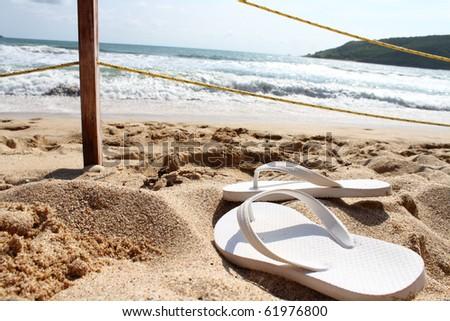 white sandals on the beach in mazatlan mexico - stock photo