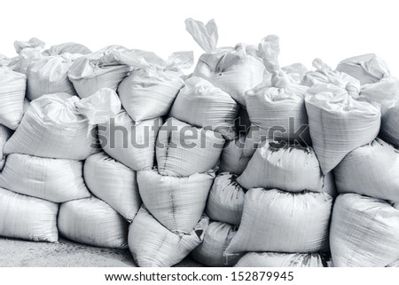 White sandbag bags are full with sand in wall formation and ready for defense. - stock photo