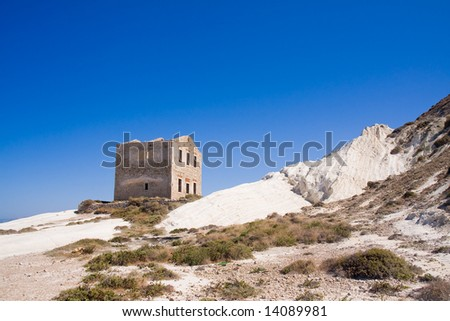 white sandstone cliffs with a blue sky - stock photo