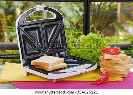white sandwich maker - stock photo