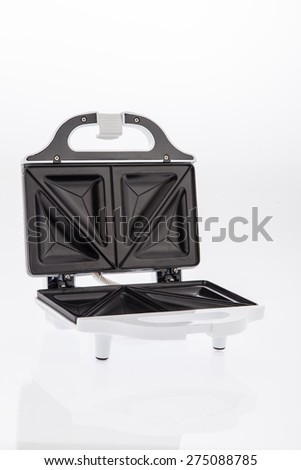 white sandwich maker opened on white background - stock photo