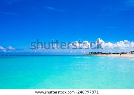 White sandy beach with turquoise water at perfect island - stock photo
