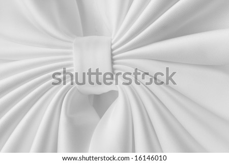White satin bow on bride's dress for textured abstract background