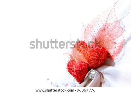 White satin drapery with two red hearts and empty space for your text - stock photo