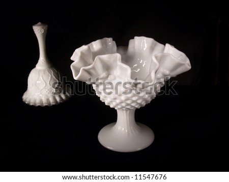 White scalloped candy dish with companion bell light-painted on a black background
