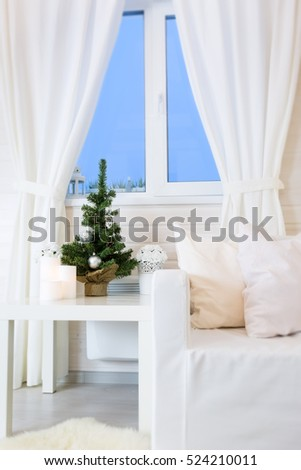 White scandinavian interior of cozy living room in wooden house decorated for Christmas holidays, nobody