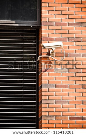 White security camera on office building, safety system