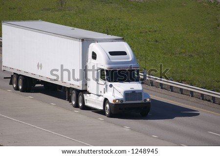 White Semi on the Highway with Copy Space - stock photo